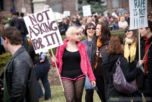 "Aww, it's me & my sign, causing a tumblr debate. Yaay? For the record, I am ""not asking for it"" just because of what I am wearing… But I am a proud slut and ""say yes"" all the time for some hot, consensual sex ♥ PS When it happened to me, I was wearing hospital scrubs.  stfufauxminists:  stfu-feminists:  stfufauxminists:  stfu-feminists:  Nice try, really. ""So, in general sluts say yes, which means that sometimes they say no…"" No. A general truth indicates that something is a fact, therefore ""sluts say yes"" worded as a general truth means that they will NEVER say no. Which would imply that they cannot be raped, since they will never not consent. Which is why it's a plain stupid sign, going against the other photo which depicts the true sentiment of the Slutwalk, which proves that even some participants of the Slutwalk have no idea what it's about. The numerous attempts to insult and mock me are ignored as usual. Any further questions? ~Z.  I'm not mocking you. I'm pointing out that it's fucking sad that you feel you have to point out one person to discredit a protest that attracted thousands. No really, what are you trying to accomplish? And if you're so critical of the way Slutwalk brings issues of rape to light, I'm curious as to what your ideas to stop rape are. Come on, man, enlighten us awful anti-rape activists with your brilliance. Oh, and by the way, a generalization is a generalization. A ""general rule"" still has exceptions, that's why it's general. Thus, it is not that it is impossible to rape sluts, and one individual person saying that she is not asking for it is not a contradiction.   ""I'm not mocking you"" Well, the second half of your last post consists of practically nothing but mockery, so I won't waste my time arguing such a blatant lie. ""if you're so critical of the way Slutwalk brings issues of rape to light"" Actually, not at all. I support its core concept. But there is an unfortunate aspect of it that subverts its whole point: the multitude of self-proclaimed feminists who have wildly varying concepts of it in their minds, along the lines of ""reclaiming the word 'slut'! Fuck yeah, proud sluts!"" etc. etc. while completely disregarding its actual point: raising awareness about rape. Kindly tell me, how does a sign that implies that the woman holding it (as well as the others present, since they all identify as sluts) will have sex with practically anyone who comes their way speak AGAINST rape? To me, it would appear that it in fact PROMOTES rape, based on the ""she had sex with tons of others, why would she refuse me of all people"" delusion. ~Z.  That's the thing, that ""she had sex with tons of others, why would she refuse me of all people"" delusion…is a delusion. I'm glad we can at least agree on that, and I mean that in earnest. Women shouldn't have to pretend like they don't have sex with lots of people in order to defend against rape or being blamed for their rapes. So, fuck yeah sex positive, fuck yeah slut positive, and fuck no rape. These concepts are not mutually exclusive, in fact, they all go together pretty well.  Sluts say yes. This is the general rule. However, if and when they say no, since it is only a general rule, that means it's still rape. Just because a  self-proclaimed or societally labeled slut says yes when asked doesn't mean that people suddenly get to stop asking. The proclamation of yes, once asked, is the exertion of agency. Never being given that opportunity is what robs one of agency and the ability to consent, thus making it rape."