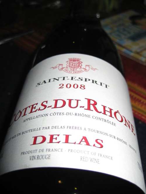Delas, Saint-Esprit 2008 Cotes-Du-Rhone  While over at World Market this afternoon, chatting with a nice gal in the wine section (where else would I be?) she suggested this lovely bottle of Cotes-Du-Rhone.  I am much more familiar with the Bordeaux from France, so this was a great opportunity to broaden my wine horizons, yet again. I have to say, this is by far the best red I've bought from World Market.  Buying wine from World Market is like buying wine from Trader Joe's.  You have to know what is good and what is not.  Research is recommended before you walk in so you make sure you're not ending up with something completely foul.  But, back to this yummy, jammy Cotes-Du-Rhone. Lots of red raspberries, cherries, green herbs and a hint of oak on the nose.  The palate opens up to continue that cherry flavor all the way to the finish, where it is met back up by those herbs and a nice smooth, dry finish.  Overall, an immensely drinkable, delicious French Red.  This wine goes great with Gruyere, so pick up as many as you dare.