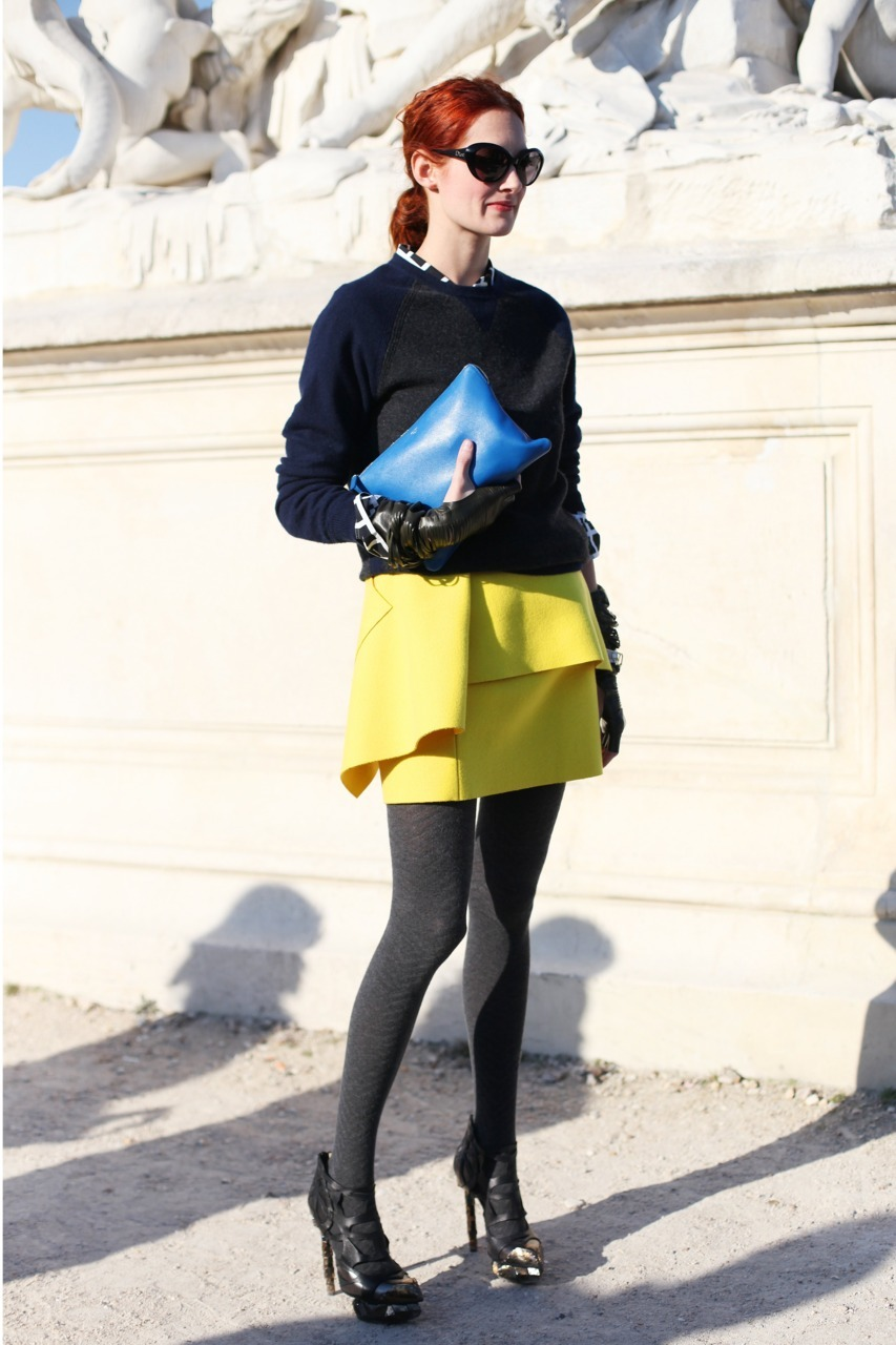 "Taylor Tomasi Hill, Tuileries Gardens, Paris Fashion week. There is something about Taylor Tomasi Hill… Everytime I see her, I am reminded why I love fashion and am always compelled to ask her a million questions - all basically alluding to ""Taylor, tell me all your fashion secrets!""  How does she wear key trend pieces, that are often over-saturated, in an original way that makes us covet them like no other can?  How does she seem to look so effortlessly chic, but still look like she is always having fun?  How does she seem to mix the same accessories throughout the month but never look the same?"