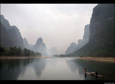 Rent a tiny boat and sail through Li River, China
