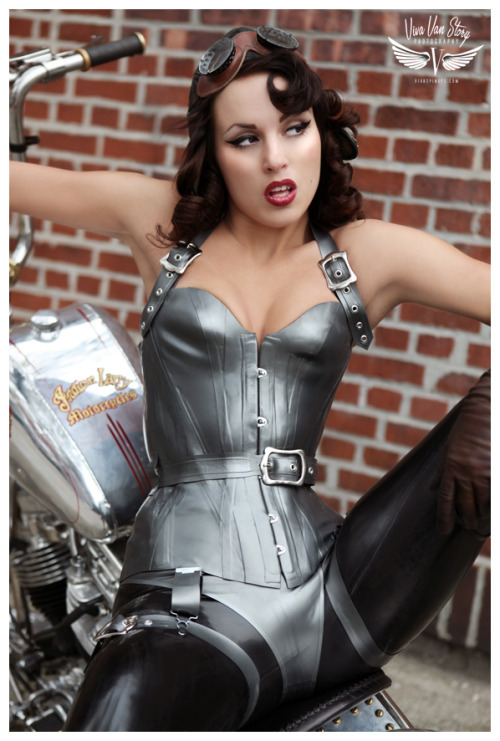 latexcatsuit:  Calamity Amelie in New House of Harlot Latex Corset on a Chopper! | House of Harlot