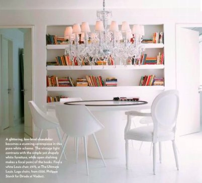Loving this modern, white dining room with a seriously-glammed-out-crystal chandelier from Living Etc.