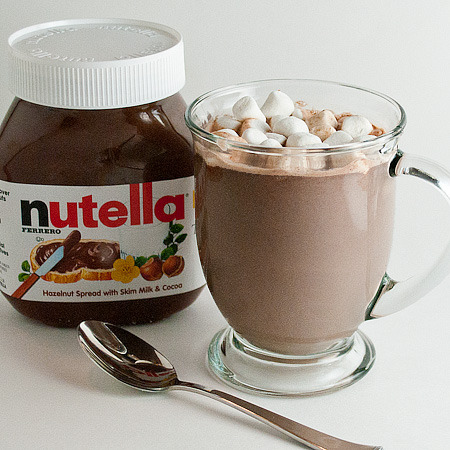 Nutella Hot Chocolate: 4 cups whole milk 1/2 cup Nutella mini marshmallows or whipped cream In a medium sauce pan over medium-low heat, whisk together milk and  Nutella until the Nutella is melted and milk gets nice and warm.  Serve  in mugs and top with marshmallows or whipped cream.  Makes 4 servings. This can be made ahead of time, cooled, and stored in the fridge.   Reheated on the stove or microwave in individual mugs.  If microwaving,  reheat each cup for about 1 minute.