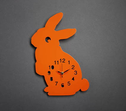 it's a bunny clock! - longing for that day i have my own apartment and can decorate with a multitude of bunnies.