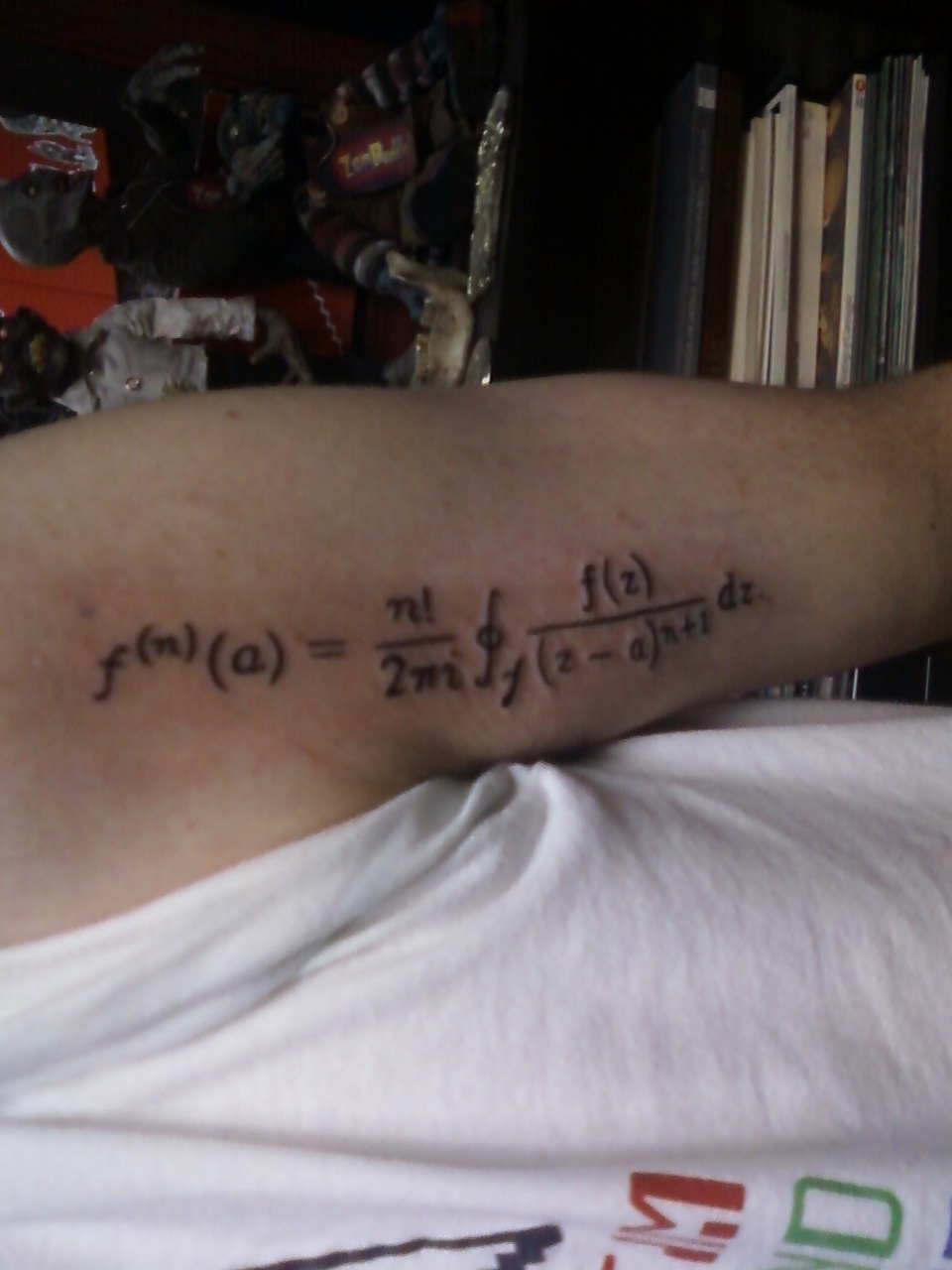 fuckyeahtattoos:  Cauchy's Integral Formula on my upper left forearm, inspired by my Complex Analysis class  Cheater!! haha jk