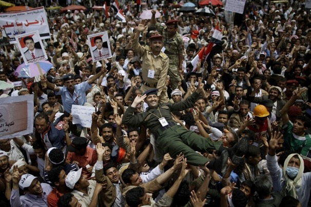 "pantslessprogressive:  A Yemeni army officer, center, salutes as he is lifted along with other officers by anti-government protesters during a demonstration on Sunday, April 10, 2011. [Photo: AP/Muhammed Muhelsen] Algeria, Bahrain, Djibouti, Ivory Coast, Saudi Arabia, Swaziland, Syria, Tunisia, UAE, Yemen Weekend News Roundup Algeria: In Algeria, a chill in the Arab spring | Washington Post HRW: Restore Civil Liberties - With State of Emergency Over, Amend Laws to Restore Rights | AllAfrica Bahrain: Two Shiite activists die in Bahraini custody | AFP Nearly 800 people have been detained since protests began | Bahrain Center for Human Rights Human rights leader missing, taken by Bahraini police | CNN Bahrain human rights activist ""arrested, beaten up"" 
