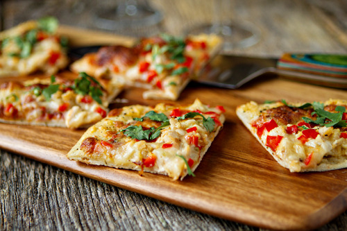 prettygirlfood:   Spicy Chicken and Pepper Jack Pizza adapted from Sargento Ingredients1 Tbsp. canola or olive oil1/2 cup chopped sweet onion3 cups diced fresh red, yellow and green bell peppers (I used all red)1 (13.8 oz.) tube refrigerated pizza dough (I used 1lb of homemade crust)1/2 cup salsa (I used fresh salsa)2 cups (8 oz.) Sargento® ChefStyle Shredded Pepper Jack CheeseChopped cilantro or dried oregano (optional)1 ½ cups cooked and shredded chicken Directions1. Heat oil in a large skillet over medium heat. Add onion; sauté 2 minutes. Add bell peppers; sauté 5 minutes or until crisp-tender.2. Meanwhile, unroll pizza dough onto a 15 x 10-inch jelly roll pan coated with cooking spray; press dough evenly to all edges of pan. Bake in preheated 425°F 8 minutes. 3. Stir salsa into cooked vegetables; spread over partially baked crust. Top with cheese.3. Bake 10 to 12 minutes or until crust is deep golden brown. Cut into squares; garnish with cilantro or oregano if desired.