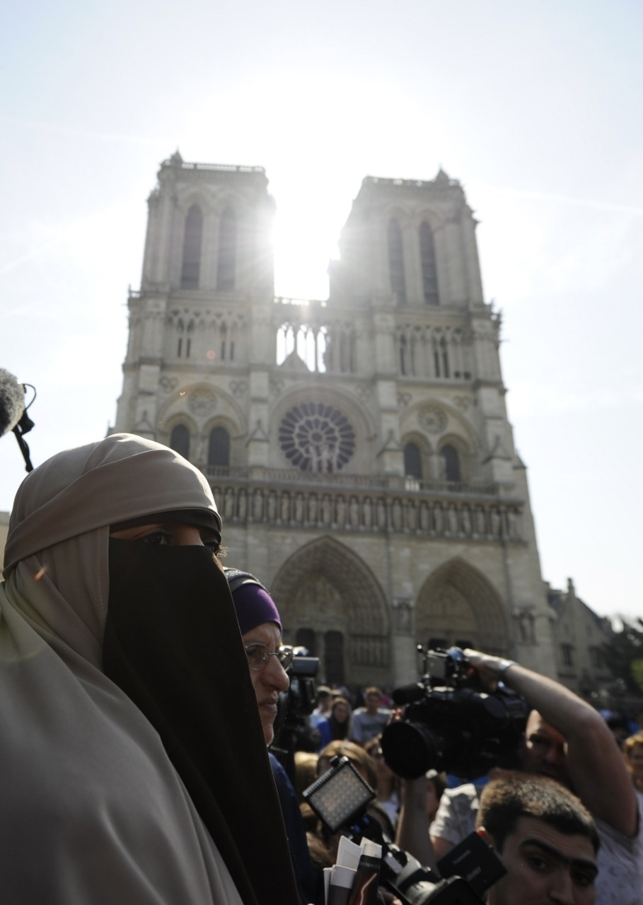 France enacts ban on face veilsFrance's ban on full face veils, a first in Europe, went into force on Monday, making anyone wearing the Muslim niqab or burqa in public liable to a fine of 150 euros (US$216) or lessons in French citizenship.Photo: Kenza Drider, a French Muslim of North African descent, wears a niqab outside the Notre Dame Cathedral in Paris, April 11, 2011. (Gonzalo Fuentes/Reuters)