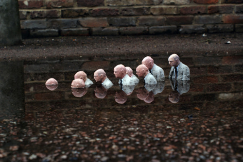 Isaac Cordal's tiny, sad street art sculptures.