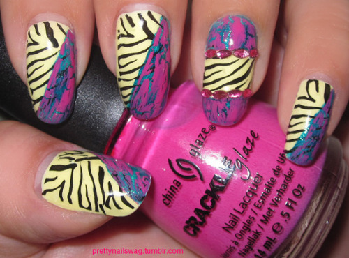 My ghetto-fab zebra-crackle nails: Hello Kitty Liquid Nail Art - Banana Cream Orly - Halley's Comet China Glaze Crackle - Broken Hearted Wet'n'Wild - Black Creme Konad IP M57 Oval shaped pink rhinestones Seche Vite Top Coat