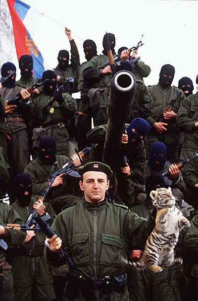 knifeintheskull:   Arkan and his Tigers   Arkan is such a badass.