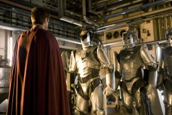 "Ladies and Gentlemen,  THE NEW CYBERMEN! …Bit similar, no?  Note the lack of ""C"" for Cybus on their chests. Replaced with a circle. Indicating that these our ""Our-Universe"" Cybermen."
