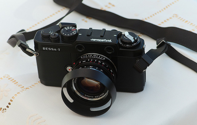 Voigtlander Bessa T by Kiloran on Flickr. This summer will be the ultimate summer of film photography for me. Or let's say it's a goal.  I've got myself into the world of rangefinder photography with this odd-bird of RF-cameras - Voigtänder Bessa T. Bought it secondhand. I still dont have it, but my friend Antto was kind enough to fetch it for me. Thanks Antto! I already had a suberb lens for it - Nokton 40mm f1.4, should be quite perfect with film. Can't wait to get my hands on this! Picture above is kindly borrowed from Flickr user Kiloran. Check his profile - there some shots taken with Bessa T.