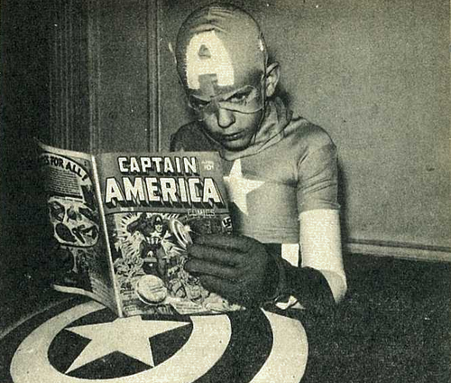 The First Avenger. via Evan Dorkin's collection of vintage photos of kids reading comics.