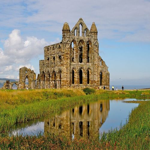 Right over the town is the ruin of Whitby Abbey, which was sacked by the Danes, and which is the scene of part of 'Marmion,' where the girl was built up in the wall.  It is a most noble ruin, of immense size, and full of beautiful and romantic bits; there is a legend that a white lady is seen in one of the windows. — Bram Stoker, Dracula