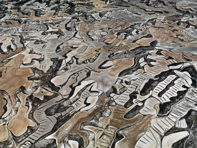 "plsj:  Edward Burtynsky - Up On The Farm  ""The jagged topography and semiarid climate that make farming an exercise  in adaptability in the remote Monegros region of northeastern Spain  also make it a painterly abstraction. High concentrations of gypsum in  the foothills — an indication that the area was once a seabed — contrast  sharply with flatter farmland. The area is planted with what grows  despite a scarcity of water: cereal grains like wheat, barley and corn.  For several days in June 2010, the photographer Edward Burtynsky says he  rented ""a pilot, a fuel truck and a helicopter"" and, from 2,000 feet  up, documented the haphazardly patterned and colored crop fields roughly  carved into the spaces between darker rock formations, after the crops  were harvested. ""You can still see a little bit of the earth and the  color of the dried crop,"" Burtynsky says. ""I think the combination of  those two things really created the kind of color palette that I like."""