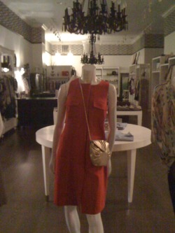 "I saw this dress in the window of a boutique on my way home the other night. I think the place is called 'Whence' or 'Whilst' or 'Mayhap'. This is one of those stores that has about six garments in it and two female employees who just loathe people. That kind of give-your-life-meaning loathing that's so popular these days. The loathing that burns hotter than a thousand Blackberry screens. The infinite, cyclical loathing of frenemies. They correctly assume that you can't afford anything in the joint and that you are there to either 1) shoplift or 2) annoy the unholy shit out of them by ""just looking"". Anyway, I couldn't help but notice this nightmare. Do y'all see the flaps positioned oh-so-conveniently over the breasticles? Giant flaps. As a woman who owns some pretty sizable boobies, I can tell you that this dress is a joke. Anybody with a B-cup up will look like ""Dolly Parton: The Inflatable Raft: The Movie"". Even if you are one of my bugbite sisters, do not purchase this abomination. Everyone will know what you're up to. Not one living person will be fooled by these flaps; not even a man. Go get yourself one of those super low-cut tops that say, ""Hey, I don't have any boobies but have you seen my sternum?"" That's a hot look, for serious. And one I can never wear. Let me live vicariously through you, Kate Hudson-type. (God, I loathe her.)"