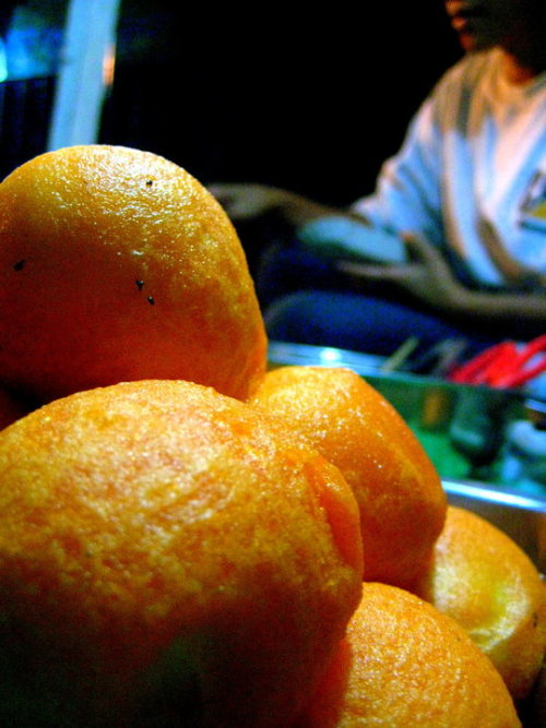 """Kwek-Kwek or Orange eggs are boiled quailed eggs coated with an orange batter and deep-fried until the batter is crispy. This is categorized as a street food and are sold along with fish balls, squid balls, and chicken balls."" The ultimate Pinoy street food. Oh, how I miss you. Took this picture way back 2009. Get the recipe here. Blogger's note: I call both the chicken and quail eggs as Kwek-kwek too! Hahaha.. lol"