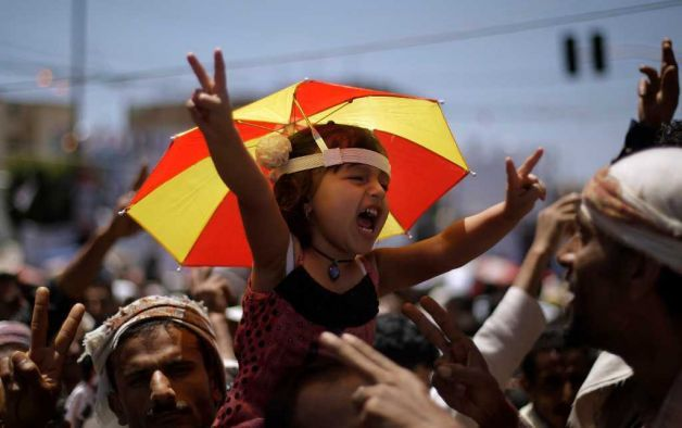 pantslessprogressive:  A Yemeni girl is held up by anti-government protestors during a demonstration demanding the resignation of President Saleh in Sana'a, Yemen on April 12, 2011. [Photo: Muhammed Muheisen / AP] Bahrain, Ivory Coast, Jordan, Saudi Arabia, Swaziland, Syria, Yemen News Roundup: April 12 Bahrain: List of people killed in Bahrain since 14th February | Bahrain Center for Human Rights Bahrain opposition figure 'dies in custody' | AJE Daughter of jailed Bahrain human rights activist says she's on hunger strike until his release | AP Bahrain questions 3 reporters, may charge activist | Reuters Bahrain urged to drop charges against editor | AFP Hospital Is Drawn Into Bahrain Strife | NY Times Bahrain Ambassador to the U.S.: CNN Report on Bahrain flawed U.S. Stays Mum as Bahrain Unleashes Brutal Crackdown | ProPublica Human Rights Watch: Suspicious Deaths in Custody Ivory Coast: Gunfire in Abidjan despite Gbagbo arrest | BBC EU urges national unity government in Ivory Coast | Reuters Obama Congratulates Ivory Coast's Ouattara on Assuming Power | Bloomberg UN names Cote d'Ivoire rights probe team | AJE France sees no long military role in Ivory Coast | Reuters Group Sees Ivory Coast Sanctions Lifted Soon | Corruption Currents - WSJ New Leader Consolidates His Control In Ivory Coast | NY Times Search for Lasting Ivorian Peace Begins | AllAfrica Danger stalks streets of tired, angry Abidjan | Reuters Sen. Inofe defends Gbagbo with 'happy face' | TPM Why France must tread carefully in Ivory Coast | BBC Analysis: Ouattara unlikely to salve Ivorian wounds | Reuters Jordan: Jordan tries 81 over March 24 demonstration | AFP Jordan releases 4 jailed members of radical Islamist group in effort to stave off protests | AP Saudi Arabia: Why the United States should push Saudi Arabia toward democracy | PRI/WNYC Swaziland: Swaziland Police Beat, Arrest Protesters | VOA Swazi forces fire at crowds to halt anti-king protest | Reuters Unions' Leadership Arrested | AllAfrica Swaziland security forces target journalists | Committee to Protect Journalists University of Swaziland Students Unanimously Endorse Uprising | AllAfrica Syria: Syrian soldiers shot for refusing to fire on protesters | Guardian Syrian protesters 'barred from medical care' | AJE Syrian forces arrest 200 in rebellious town, says lawyer | Reuters Witnesses say Syrian gunmen attack 2 villages as regime tries to quell uprising | AP Syrian University Protests Violently Suppressed | NY Times Video shows Syria clash from two angles | The Lede No end in sight | The Economist Comment: White House finally condemns Syria | Guardian Yemen: Yemenis protest against mediation deal offering president immunity from prosecution | AP Yemen opposition seeks details on Gulf plan | Reuters Yemen protesters vow to stay in Sanaa square | AFP Argument: Who's Really In the Yemeni Opposition, Anyway? | Foreign Policy Argument: Twilight of a Strongman | Foreign Policy
