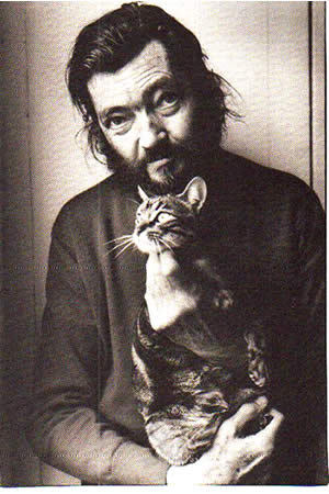 Julio Cortazar and kitty, self-portrait.