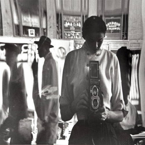 Self-Portrait in a Distorted Mirror, 42nd Street, New York, 1950 by Eve Arnold
