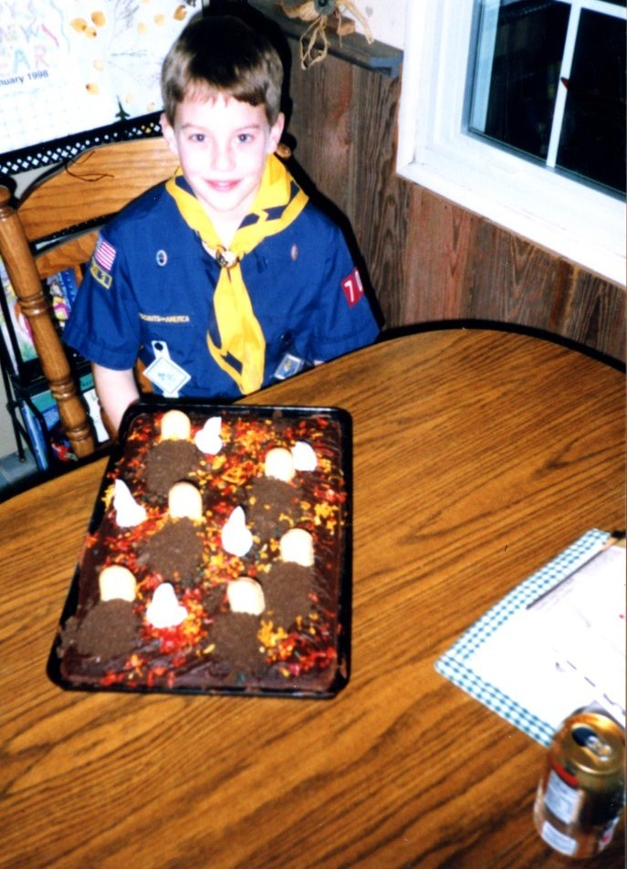 Pictures of me with my award-winning boy scout cakes. This is some top-notch cake baking.