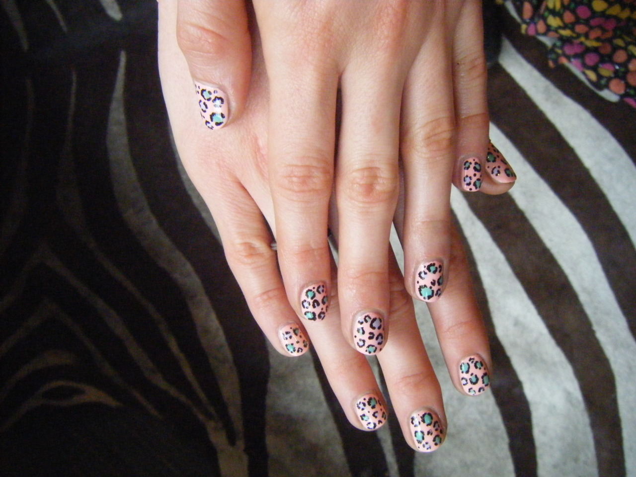 Spring Leopard Manicure | ReadyMade Oh my gosh, this is the cutest manicure I've ever seen! And it's DIY! The summery colours and modern design totally get me. I think I need to guy and buy some of those manicure pens now so I can do this.