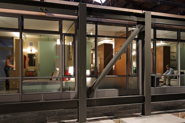 fastcompany:   In Seattle, a wood-frame apartment building with parking is $130,000 a  unit. It also takes an interminable 36 to 40 months for design and  construction.   Next week, a company called Sustainable Living Innovations will introduce  the new future of the urban built environment: the prefab skyscraper.   SLI's building costs the same—but it can be designed in  less than 20 months. So for the same price as a building featuring a  wood frame, vinyl windows, a popcorn ceiling, and an ugly beige carpet,  SLI can build a steel-framed building with concrete floor slabs and  ample natural lighting, right out of an IKEA catalog.