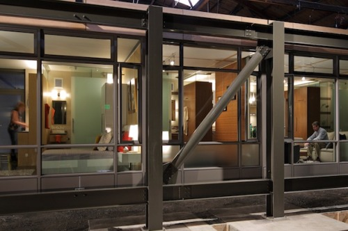 fastcompany:   In Seattle, a wood-frame apartment building with parking is $130,000 a  unit. It also takes an interminable 36 to 40 months for design and  construction.  Next week, a company called Sustainable Living Innovations will introduce  the new future of the urban built environment: the prefab skyscraper.  SLI's building costs the same—but it can be designed in  less than 20 months. So for the same price as a building featuring a  wood frame, vinyl windows, a popcorn ceiling, and an ugly beige carpet,  SLI can build a steel-framed building with concrete floor slabs and  ample natural lighting, right out of an IKEA catalog.   This is good news?