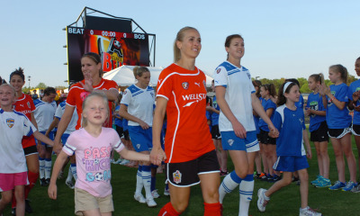 The Atlanta Beat and Boston Breakers walk onto the field for the first game of the WPS season last Saturday in a game won by Boston 4-1. This a great image for the two teams to be taking the field together and encouraging all the little girls who want to grow up to be soccer players to be right there with them.