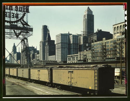 "View from Illinois Central Freight Terminal, Chicago, Illinois Historic 1943 photo - Library of Congress View of Chicago from a rail yard that later, someone notes on Flickr, became the site of Millennium Park. The tall Deco tower on the right is the Pittsfield Building. From LoC:  Delano, Jack, photographerGeneral view of part of the South Water street Illinois Central Railroad freight terminal, Chicago, Ill.1943 April  This photo comes from an extraordinary photo collection available on Flickr — ""1930s-40s in Color."" Very few of the photos are anything Deco, as much of the photos are  documentary photos of rural farm workers, WWII factory workers,  Depression-era shantytowns, etc., but I found a few I'll be sharing."