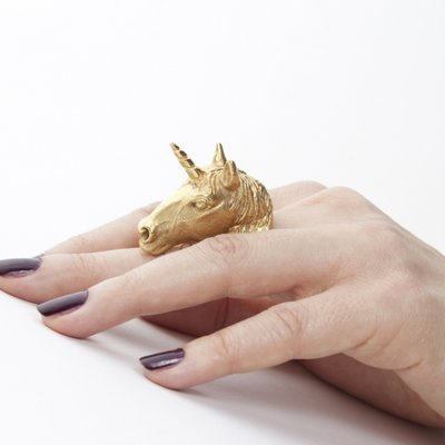 Gold unicorn ring and purple nail polish = Delta Phi Epsilon