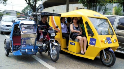 flyingjeepney:  LIKE A BOSS: E-trikes roll out in Mandaluyong The first time you see them, you're probably gonna do a double take, but say hello to the future of commute in the country. Introducing the electric-powered tricycles, or simply, e-trikes. In support of efforts to make a greener future, the government recently turned over to the city of Mandaluyong, 20 e-trikes. These energy efficient e-trikes use rechargeable lithium ion batteries, much like your laptop and cellphones, and can be docked to four available recharging stations in Mandaluyong.  Do you want one in your city? Don't worry, plans are being made to significantly scale up the roll out of e-trikes by next year. Also: E-jeepneys in Makati and Quezon City. [via asiancorrespondent]