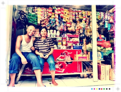 Chillin' with Iba Ayu at her bodega in Stevie G's hood in Bali. She's got the bomb homemade spring rolls and will school you on how to keep the bad spirits away.
