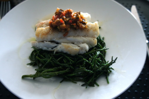 Samphire, roasted cod and ratatouille Samphire is not actually a seaweed but a succulent which grows in tidal zones (estuaries, creeks, etc). It has a nice crunch to it, with a slightly salty flavour and provides a bright vegetable addition to the dinner plate. It can be foraged, but it's recently become quite trendy so is much more easily available at the fish counter. It goes very well with fish. This recipe serves 2. Take a large handful of washed and trimmed samphire and snap into 2-3 cm pieces. Place a knob of butter in a pan (or substitute with olive oil) and stir fry the samphire for around 2-4 minutes, until the samphire starts to soften nicely. Season with sea salt and pepper, add a squeeze of lemon juice. Serve with a couple of nice pieces of grilled cod on top of the samphire with a garnish of ratatouille on top. You'll find the recipe for the ratatouille here. A wedge of lemon wouldn't go amiss either.