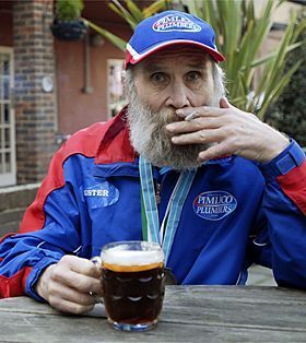 "Obit of the Day:  World's Oldest Kinda Old Marathoner   Keeping with the unintentional trend of supercentenarians, we honor Buster Martin. Martin, who died at age 104 (or 97) was said to be Britain's oldest worker, retiring at 100 (or 93) and the world's oldest marathoner (101, or 94). Why the discrepancy? Well apparently Mr. Martin has two birthdates on record with Britain's National Health Service, September 1, 1906 and September 1, 1913. The latter date would make him old, but not record-holding old. Since he was born in France, supposedly, his birth certificate has not been found and verified.  Martin owed his long-life, whether or not it lasted one hundred years, to smoking, drinking, and red meat. The photo above shows Mr. Martin with his pint, his smoke and two running medals, including that from the London Marathon he completed, perhaps at age 101.  Coolest achievement? Putting together forty senior citizen singers, combined age over 3000, to record a cover of The Who's ""My Generation,"" which became a hit in England.  He's also prominently featured in the upcoming documentary, How To Live Forever. His age on the site? 101.  (Image courtesy of Guidespot, guidespot.com)"