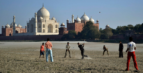 Boys play cricket near the Taj Mahal in Agra, India January 22. (Pawan Sharma/AP) #