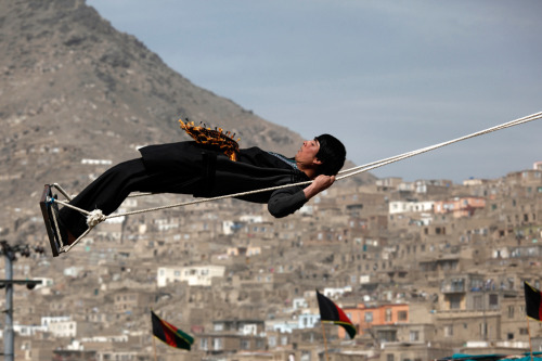 An Afghan boy swings on the occasion of Nowruz, held at the Sakhi Shrine in Kabul on March 21. (Dar Yasin/Associated Press) #