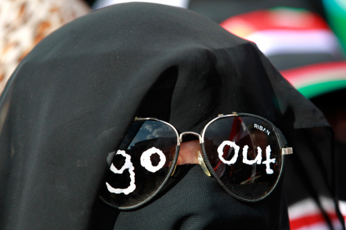 A woman with her message written on her sunglasses takes part in a demonstration to demand the ouster of Yemen's president in the southern city of Taiz, April 14, 2011. Yemen's opposition set a two-week deadline for Saleh to step down. (Khaled Abdullah/Reuters).
