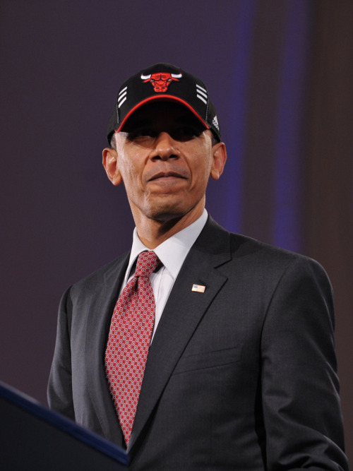 PHOTO OF THE DAY: President Obama wears a Chicago Bulls cap after speaking at a  Democratic National Committee fundraiser on Thursday night at the Navy  Pier in Chicago. Obama is in Chicago to attend a series of DNC  fundraisers. (MANDEL NGAN/AFP/Getty Images)