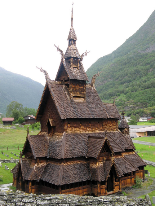 Borgund Stave Church (Bokmål: Borgund stavkirke, Nynorsk: Borgund stavkyrkje) is a stave church located in Borgund, Lærdal,Norway. It is classified as a triple nave stave church of the so-called Sogn-type. This is also the best preserved of Norway&#8217;s 28 extant stave churches.<br /> Borgund was built sometime between AD 1180 and 1250 with later additions and restorations. Its walls are formed by vertical wooden boards, or staves, hence the name stave church. The 4 corner posts were connected to one another by ground sills, resting atop a stone foundation.1 The rest of the staves then rise from the ground sills, each stave notched and grooved along the sides so that they lock into one another, forming a sturdy wall.2&#8243; /></a></p> <div> <p><strong>Borgund Stave Church</strong> (<a title=