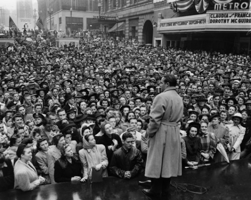 Bob Hope Speaking to Crowd in Victory Square, Seattle, 1942 Victory Square, on University Street between Fourth and Fifth Avenues, was the hub of Seattle's home front activities during World War II. Crowds gathered here for parades, war bond rallies and many other patriotic events. This photo shows a crowd gathered at the square to hear entertainer Bob Hope. Photographer: Seattle Post-Intelligencer Staff Photographer Image Date: 1942 Image Number: PI28264  To order a reproduction or to inquire about permissions contact photos@seattlehistory.org or phone us at 206-324-1126. Please refer to the Image Number and provide a brief description of the photograph.