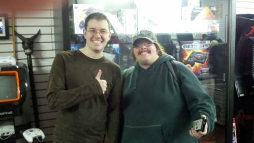 This is a picture I took with the Angry Video Game Nerd up at Digital Press back in November. I waited 5 hours in line the first 3 in the cold just to get an autograph from Mike (the guy who plays most the side characters in his videos) and James (the AVGN) and I even took a picture with him which was awesome.