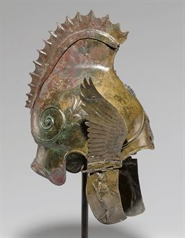 theancientworld:  A Greek bronze winged helmet of Phrygian-Chalcidian type, late Classical Period, circa 4th century B.C.