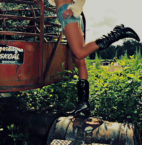 um…amazing legs!!! much! and i want those boots!