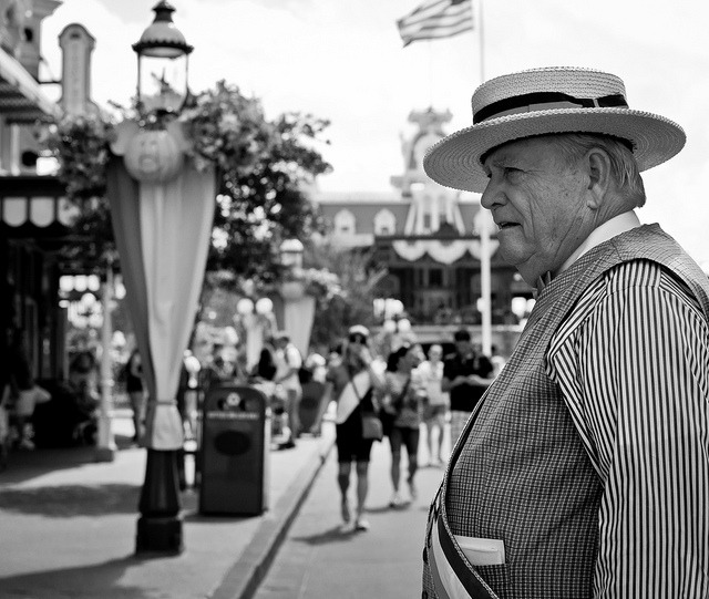 Mayor of Main Street, U.S.A. by Adam Hansen   I always find myself spending time on Main Street capturing the different characters. Mayor Weaver is a lot of fun to shoot because he really gets into interacting with the guests. This shot was taken as he was watching a little boy on the sidewalk crying. Mayor Weaver got very serious then went over and started talking to the boy and his family to make sure everything was okay. Of course he ended it by telling them he had to make sure his future little voter was okay because every vote counts :) - Adam Hansen
