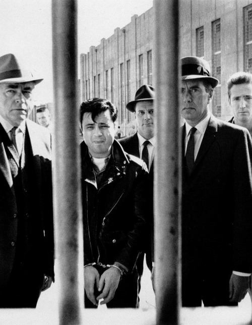 "Robert Blake, John Forsythe, and Scott Wilson in In Cold Blood (1967, dir. Richard Brooks) ""Although none of the journalists anticipated violence, several had predicted shouted abuse. But when the crowd caught sight of the murderers, with their escort of blue-coated highway patrolmen, it fell silent, as though amazed to find them humanly shaped."" -Truman Capote, In Cold Blood (1966)  Photographer: Phil Stern"