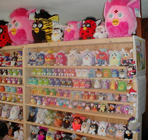 oneside-ofanampersand:  THIS IS TERRIFYING  I remember when all the toy store shelves looked like this.  Why would someone create this horrifying sight in their home?  haha well, let's play… I Spy My Furby.  I spy my Furby in the bottom right corner (all black/white feet).  LOL
