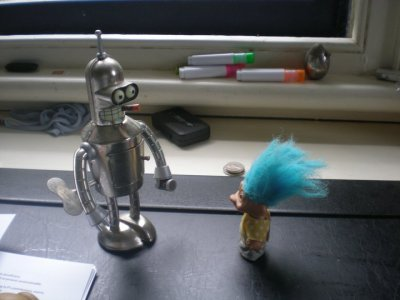 Bender V.S. TrollWould you rather rub a troll's hair for good luck, or kiss Bender's shiny metal ass? (Thanks to Charlie Shute) 07/11/2010