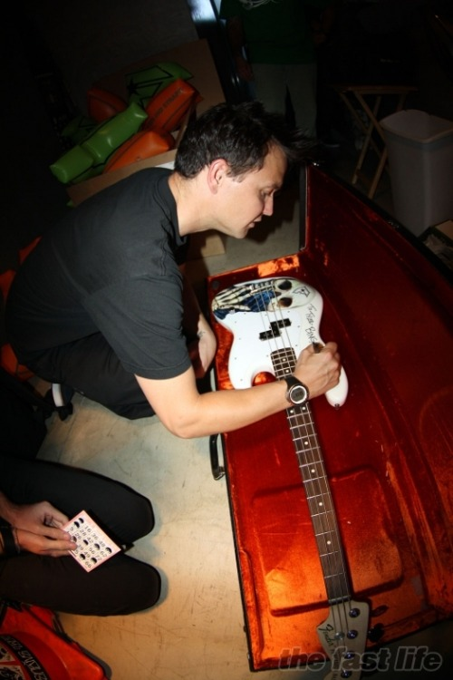 Mark signing his bass for a giveaway.